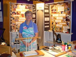 Book Binding Demonstration at Guild Fair in Asheville, NC by Dea Sasso