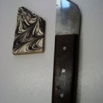 Old German steel blade knife retooled as a right hand paring knife with decorative marbled cap.